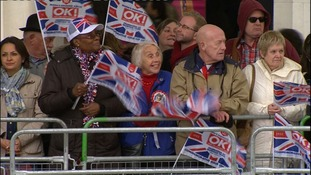 Crowds gather to catch a glimpse of the Queen.