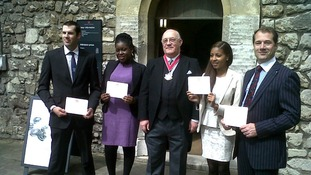 Tanya Whyte and other guests holding up their invitations to the Diamond Jubilee lunch.