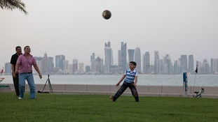 A family plays football in Doha, the capital of Qatar.