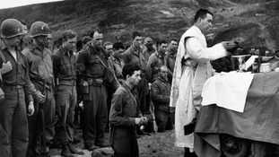 A Catholic mass pictured after the landings.