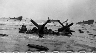 Soldiers take cover as they advance to shore.