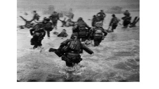 Capa's iconic image shows American troops landing on Ohama Beach on 6 June.