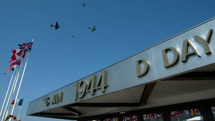 Aircraft from the Battle of Britain Memorial Flight pass over the D-Day museum in Arromanches, Normandy