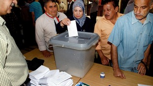 A Syrian woman casts her vote.