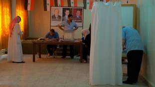 People voting at a polling station in Damascus June 3, 2014.