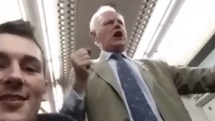 The rail passenger mid-song, going from Victoria station in London to Ashford International in Kent on Friday