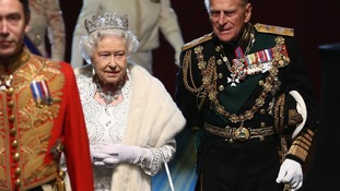 Queen Elizabeth II and the Duke of Edinburgh after the state opening of Parliament last year.
