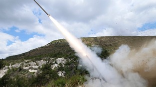 Rebel fighters fire a Grad rocket at forces Loyal to Bashar al-Assad.