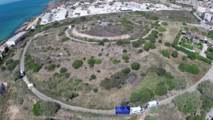A remote-control drone takes images of the four-acre site surrounding the Algarve resort where Madeleine McCann vanished in 2007.