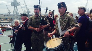 Music is played for the assembled veteran in Portsmouth.