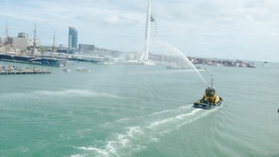 A water cannon salute as the ferry departs for Normandy.