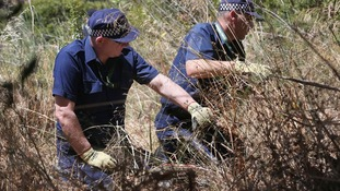 Police were seen searching one particular area of the cordoned-off wasteland.