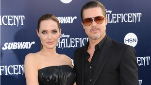 "Angelina Jolie & Brad Pitt attending the premiere of ""Maleficent"" in LA."