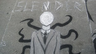 Slender Man is often depicted as a tall figure in a dark suit bearing tentacles.