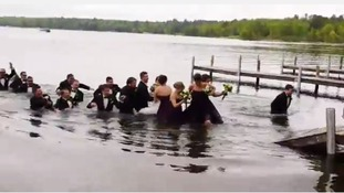 The party of 22 was too much weight for the decking and it collapsed leaving the party chest-deep in the lake.