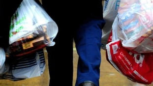 The Government has bowed to pressure to introduce a charge on single-use carrier bags to cut litter.