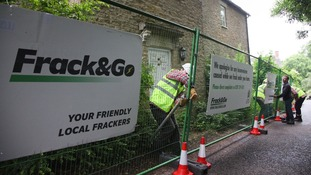 Greenpeace protesters demonstrating against fracking outside David Cameron's country home.