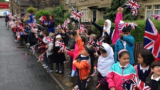 Pupils from Newby Primary School prepare to welcome the Duke of Cambridge to Bradford.