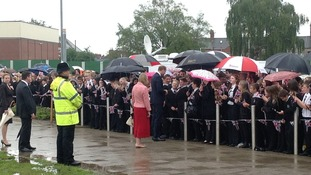 Prince William talks to pupils in the rain at Goole High School