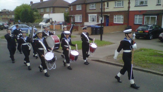Sea cadets march to their street party in Enfield.