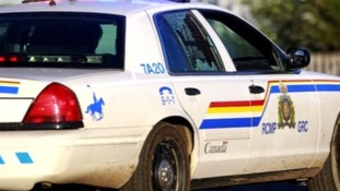 A police car window with a shot-out window at the scene of the shootings in Moncton, Canada.