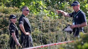British police check an area of scrubland during the search for evidence of Madeleine McCann, in the town of Praia da Luz in Portugal.