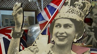 A cardboard cut-out of the Queen.