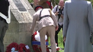 Charles lays the wreath at Pegasus Bridge.