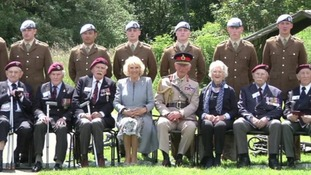 Charles and Camilla posed for a photo with veterans after the ceremony.