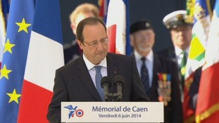 French President Francois Hollande addresses the D-Day veterans.