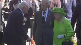 The Queen arrives at the Commonwealth War Graves Cemetery in Bayeux.