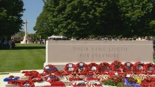Wreaths placed at the memorial in Bayeux cemetery where the memorial service took place.