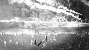 Smoke billows as the allied troops land at Gold Beach on D-Day.