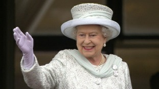 The Queen waves to the crowds before leaving the balcony of Buckingham Palace