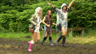Three music fans in ponchos and wellies at Heaton Park