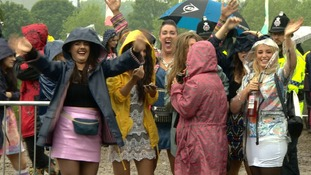 Group of women in coats and wellies at muddy Heaton Park for Parklife Festival