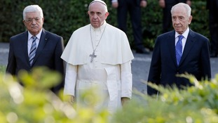 Palestinian President Mahmoud Abbas, Pope Francis and Israeli President Shimon Peres arrive in the Vatican Gardens.