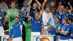 Rest of the World's Michael Sheen and Gordon Ramsay lift the Soccer Aid trophy
