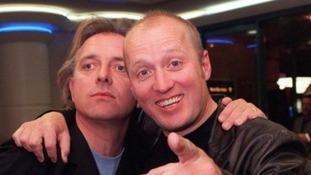 Rik Mayall, who has died aged 56, with comedy partner Ade Edmondson.