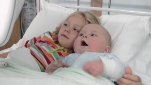 Claudia (left) in 2011. Her 'turned in' eye is what gave her brain tumour away.