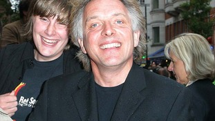 Comic Rik Mayall, who died aged 56, at a film premiere in London in 2004.