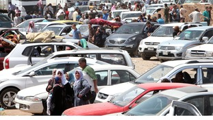 Heavy delays as thousands attempt to flee Mosul at the outskirts at Arbil.