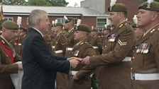 The First Minister presenting medals to troops