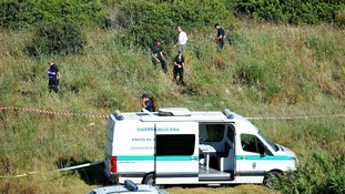 British police and their Portuguese counterparts search a second area of scrubland.
