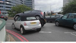 Car lands on top of Mini after crash