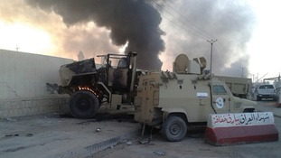 Damaged vehicles belonging to Iraqi security forces seen during yesterday's clashes.