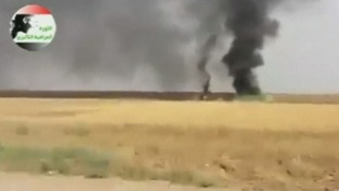 Footage is said to show smoke billowing from the old refinery town of Baiji.
