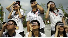 South Korean students use special glasses to observe the transit of Venus at National Science Museum