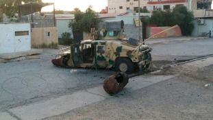An abandoned Iraqi security forces vehicle on a road in Tikrit, which was overran by ISIS yesterday.