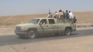 Iraqi troops, some in civilian clothes, retreat from Kirkuk.